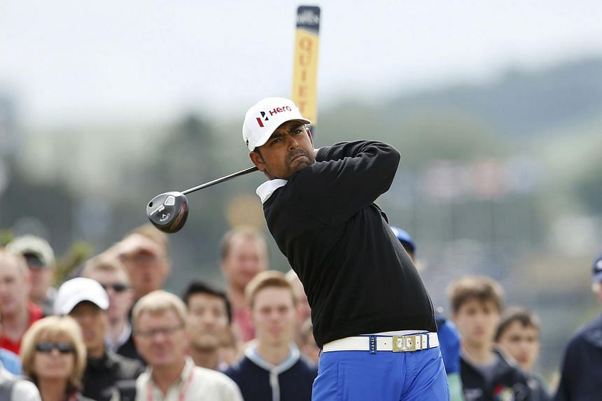 Anirban Lahiri of India watches his tee shot on the fourth hole during the final round of the British Open.