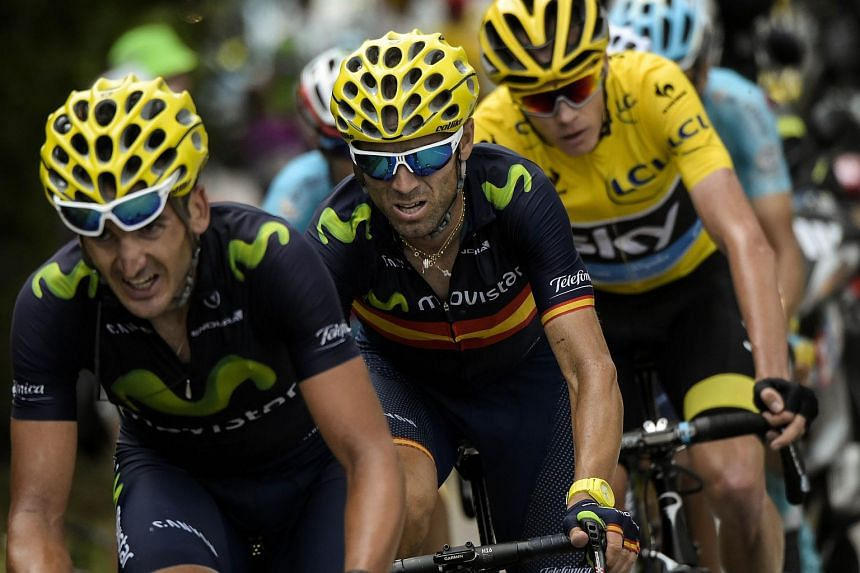 Christopher Froome of Great Britain (in yellow jersey) rides behind Spain's Alejandro Valverde (centre) during the 17th stage of the Tour de France on July 22, 2015.