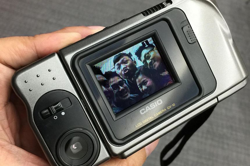 A group selfie taken with the Casio QV-10.