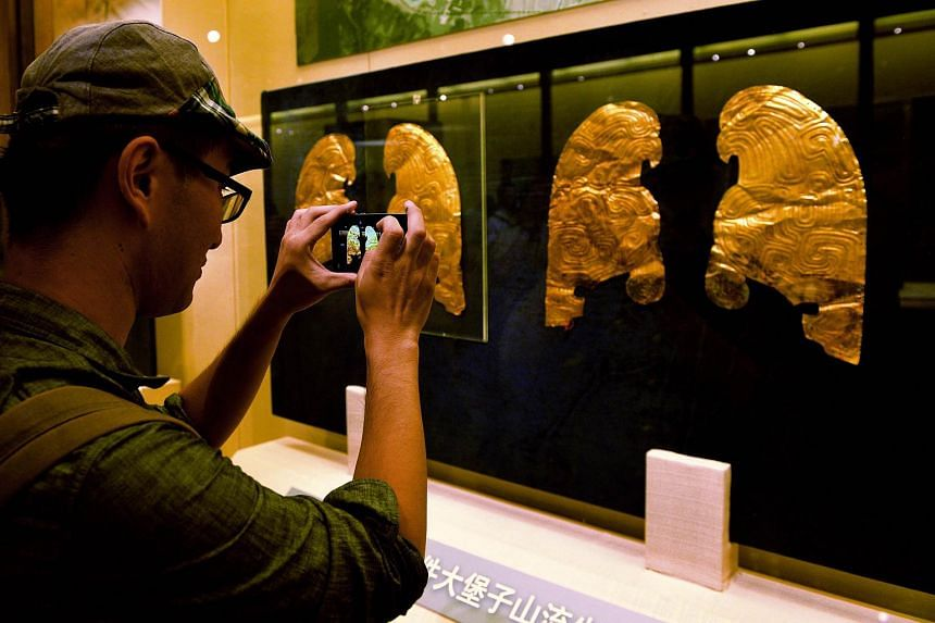 Gold ornaments displayed at a public exhibition of Chinese cultural relics returned by French private collectors.