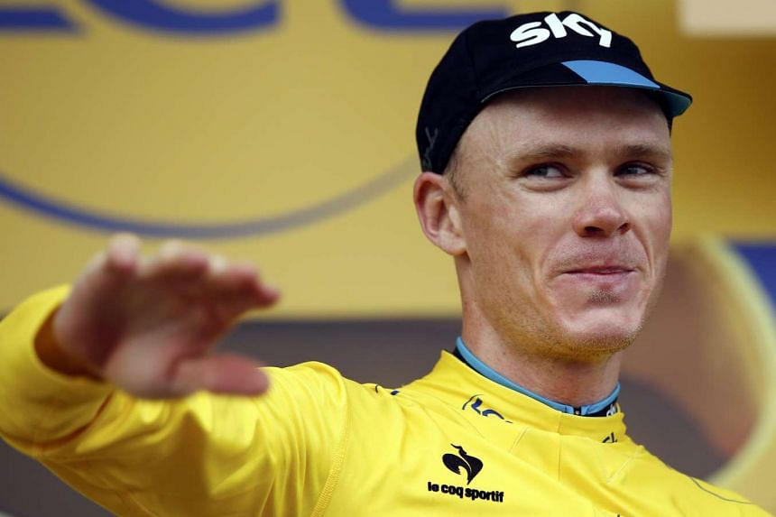 Team Sky rider Chris Froome, the overall leader's yellow jersey holder, on the podium of the 102nd Tour de France cycling race.