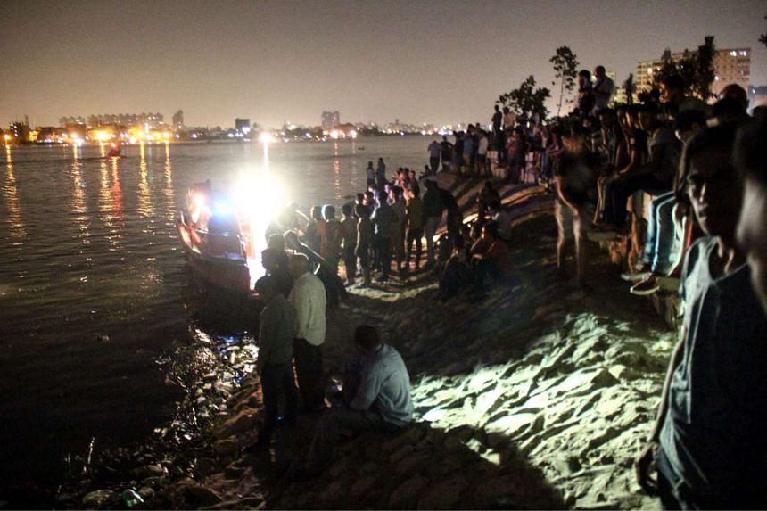 People gathering along the banks of the Nile during the search for victims of the ferry accident.