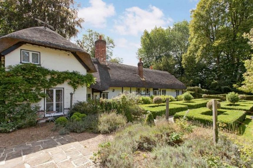The thatched cottage that was once owned by popular children's writer Enid Blyton has been put up for auction.