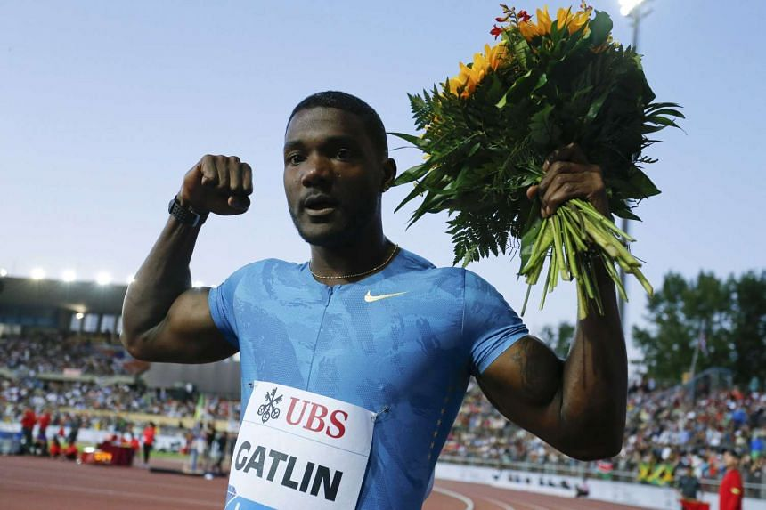 Gatlin celebrates after winning the 100m at the IAAF Diamond League Athletissima athletics meeting.