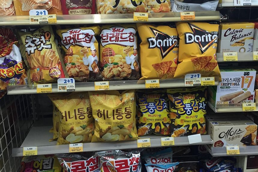 Honey butter flavoured snacks seen displayed on the shelves of a minimart in Seoul. But the original Honey Butter Chip by Haitai-Calbee is nowhere to be seen.