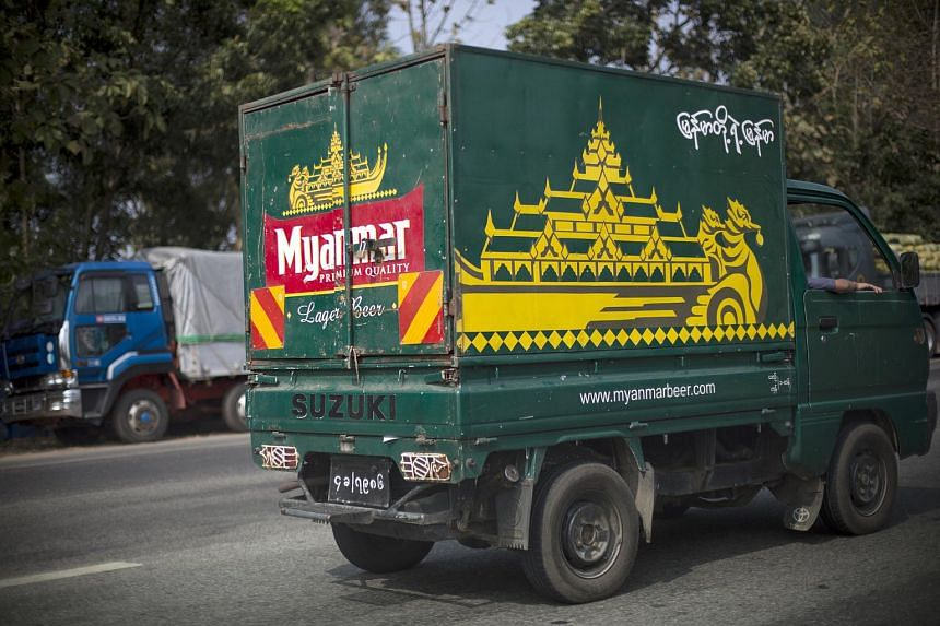 A Myanmar Beer truck driving along a road in Yangon, Myanmar.