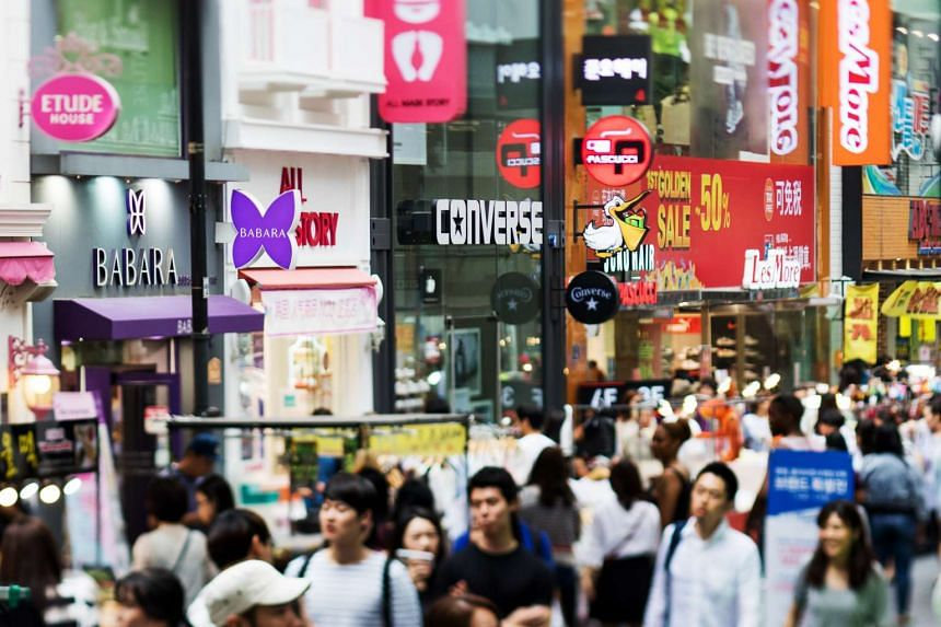 Shoppers at South Korea's Myeongdong district. The country's economy grew just 0.3 per cent in April-June.