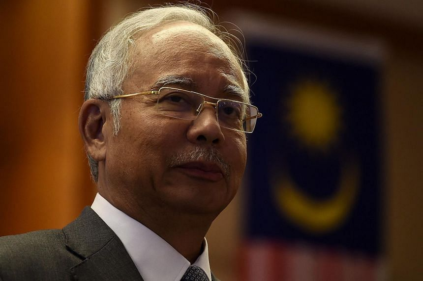 Prime Minister Najib Razak's (above) lawyers are mulling over the next course of action against WSJ.