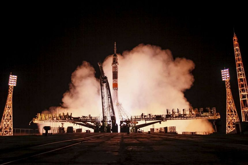 The Soyuz TMA-17M spacecraft carrying the ISS crew blasting off at the Baikonur cosmodrome, Kazakhstan.
