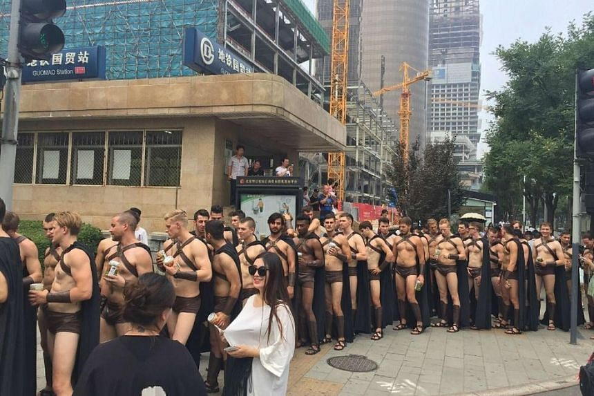 The men were wearing dark capes and skimpy shorts as part of a restaurant marketing stunt.