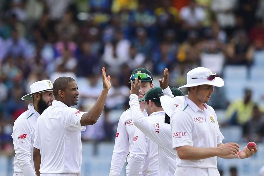 South Africa cricketer Vernon Philander celebrates with teammates during the second day of the first cricket Test match between Bangladesh and South Africa.