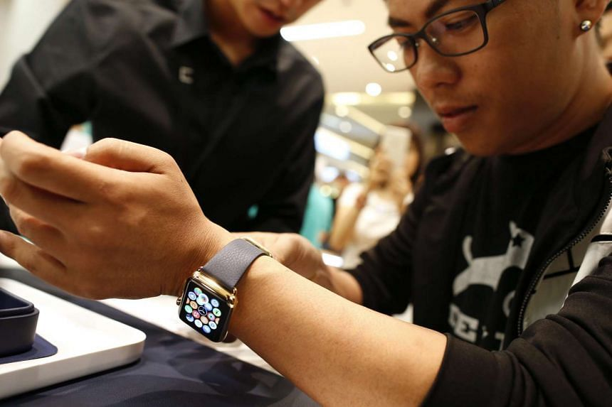 A Thai customer purchases an Apple Watch at a Bangkok shopping centre.