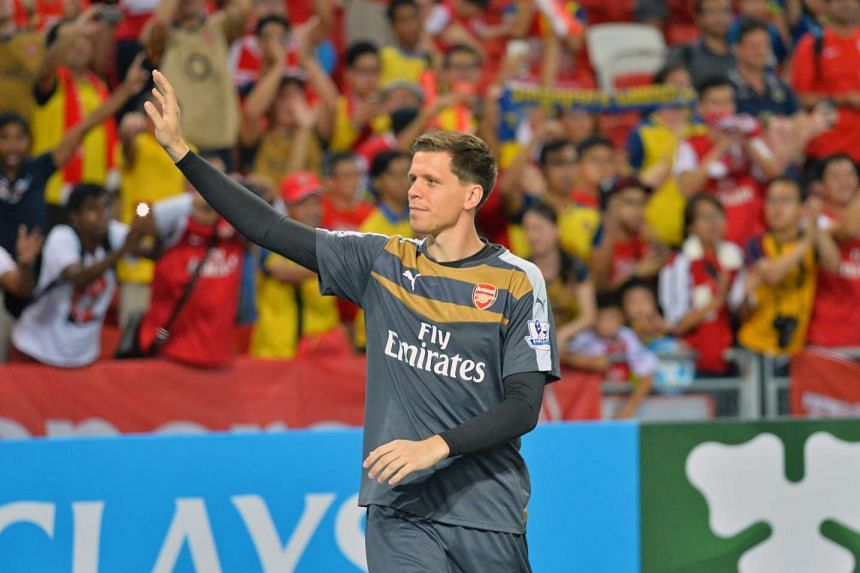 Wojciech Szczesny greets the fans after the match between Arsenal and Singapore Select 11 during the Barclays Asia Trophy.