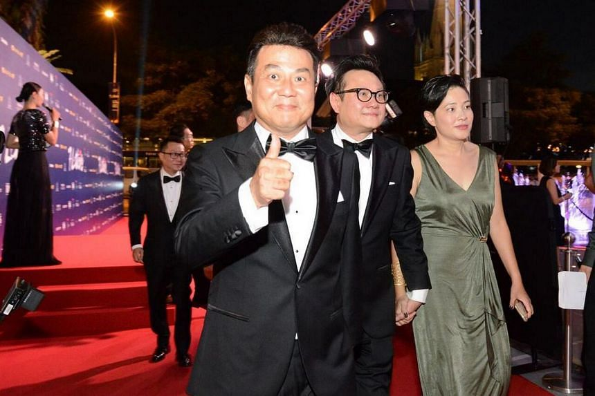 Directors (from left) Kelvin Tong, Jack Neo, Eric Khoo and Tan Pin Pin walking down the red carpet.