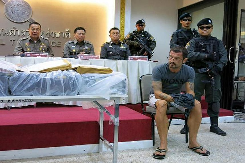 Swiss national Xavier Andre Justo in a photo issued by the Thai police after his arrest. He claimed a deal was reached in Singapore in February on the sale of stolen documents which was followed by discussions on how he would be paid. The group of pe