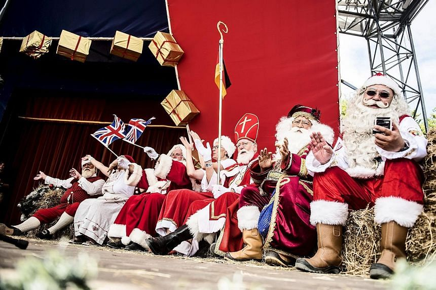 Participants in the World Santa Claus Congress, which brings together Santas from across the world, seen in Copenhagen, Denmark, on Wednesday. The three-day event - which features activities including parades, a Santa Obstacle Course and shows at the