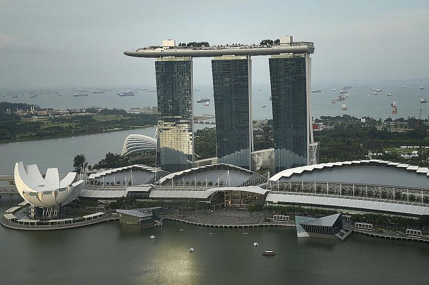 Marina Bay Sands suffered a steep 11.4 per cent decline in revenues to $974 million. Its revenue per available room and average daily rate were undermined by a strengthening greenback against the Singdollar amid expectations the US central bank will