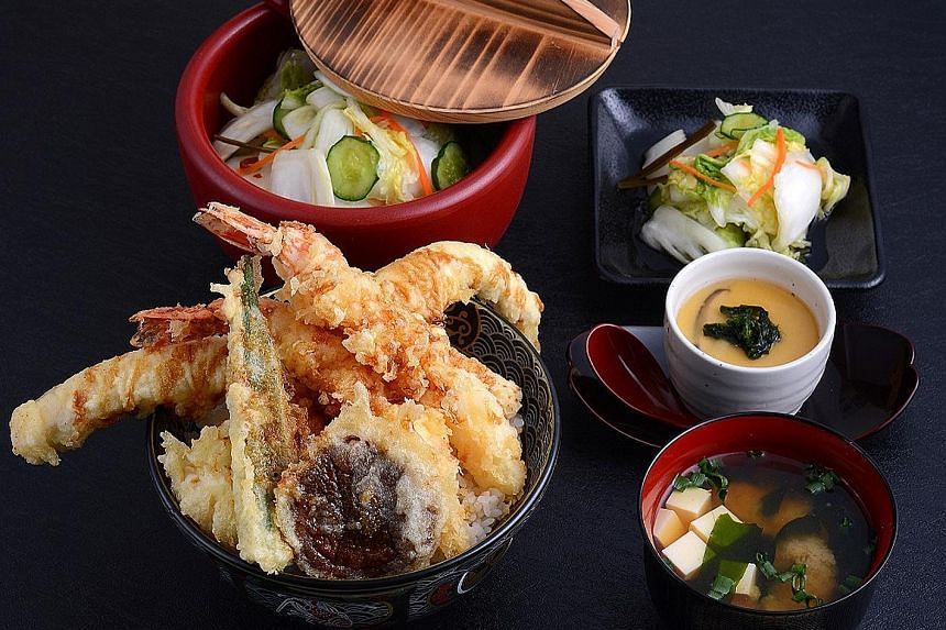 Special Tendon - two pieces of chicken breast, two prawns, a whole fresh shiitake mushroom, baby corn, lady's finger and a runny egg, all coated in tempura batter and fried to a crisp, and served with hot rice.