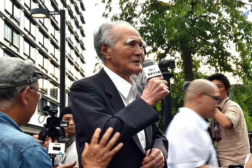 Former Japanese premier Tomiichi Murayama speaking at yesterday's anti-government rally in Tokyo. While in power in 1995, Mr Murayama made a landmark apology for the wartime damage caused by Japan.