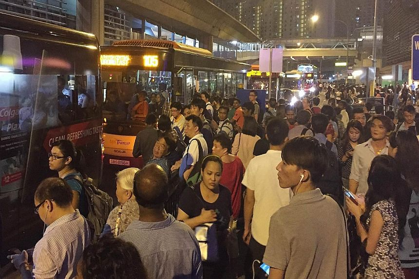 Commuters jostling for buses outside an MRT station after a train disruption. In the latest National Values Assessment survey, many respondents also said they felt society was materialistic and self-centred.