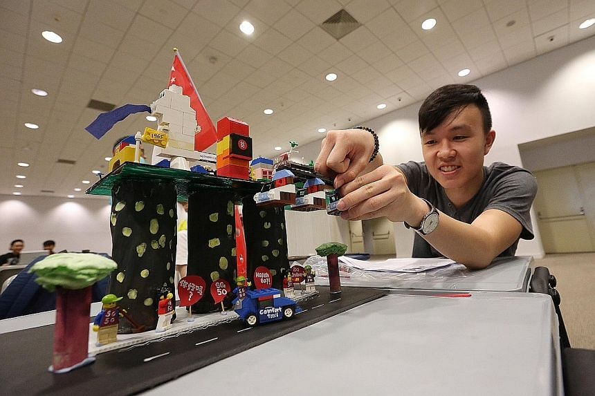 Mr Eugene Seow, 18, putting the finishing touches on a Lego structure representing his vision of Singapore, featuring cable cars as well as the towers of Marina Bay Sands. He was one of about 1,000 students from Republic Polytechnic who took part in