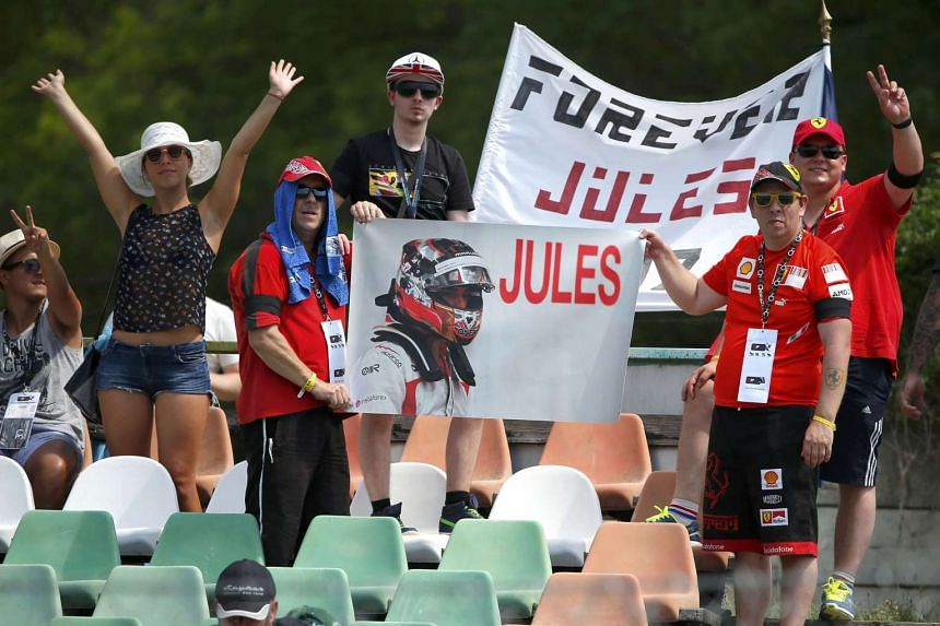 F1 supporters hold a banner in memory of late French Formula One driver Jules Bianchi.