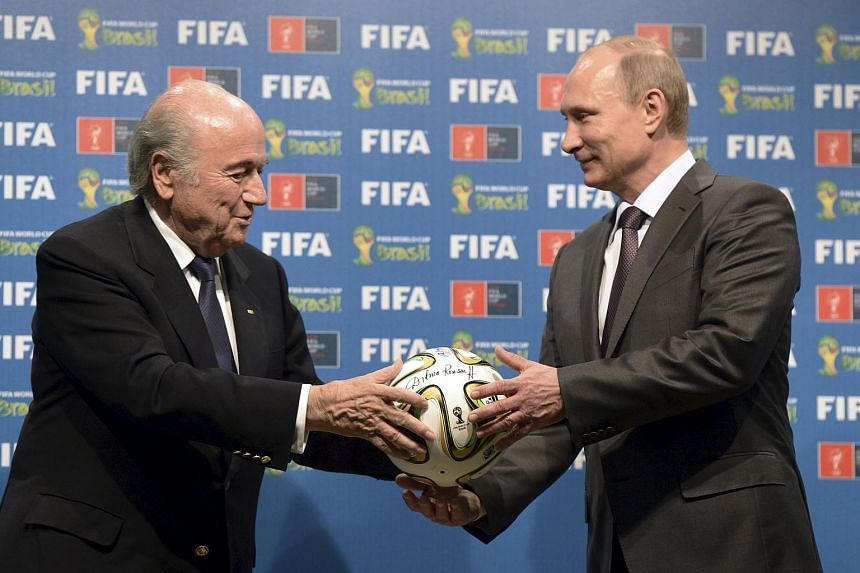 Russian President Vladimir Putin (right) and FIFA President Sepp Blatter take part in the official hand over ceremony for the 2018 World Cup, set to be held in Russia.