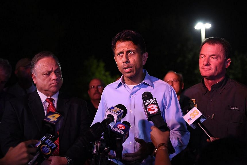 Louisiana governor Bobby Jindal speaking to reporters near the theater where a gunman opened fire on movie-goers.