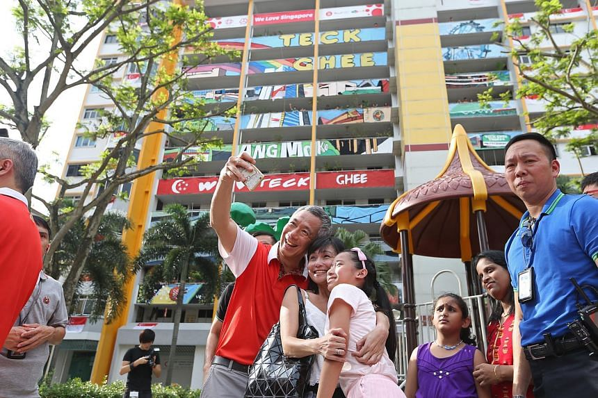 Prime Minister Lee Hsien Loong taking a selfie with residents at his Teck Ghee ward.