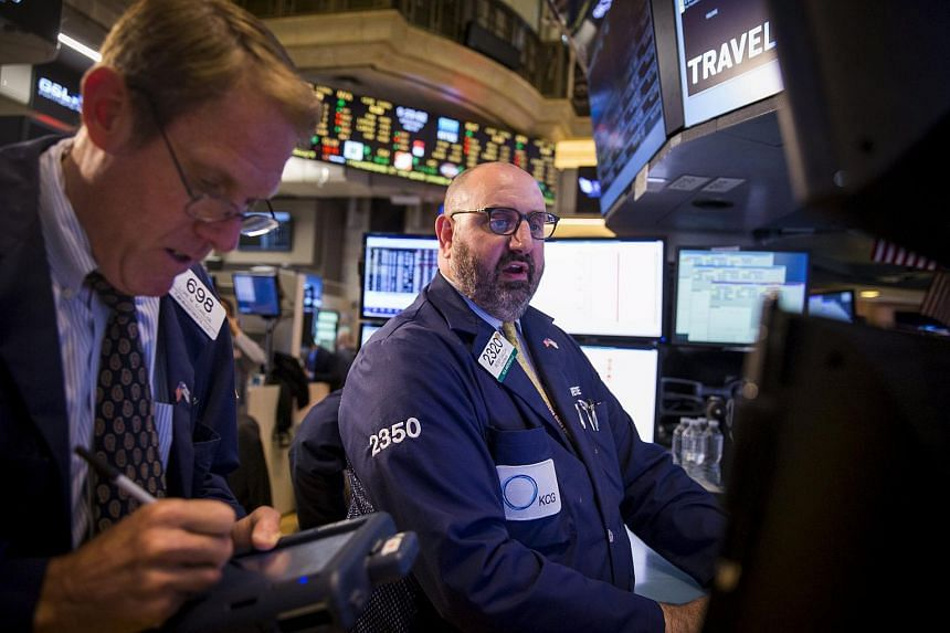Traders working on the floor of the New York Stock Exchange on July 22.