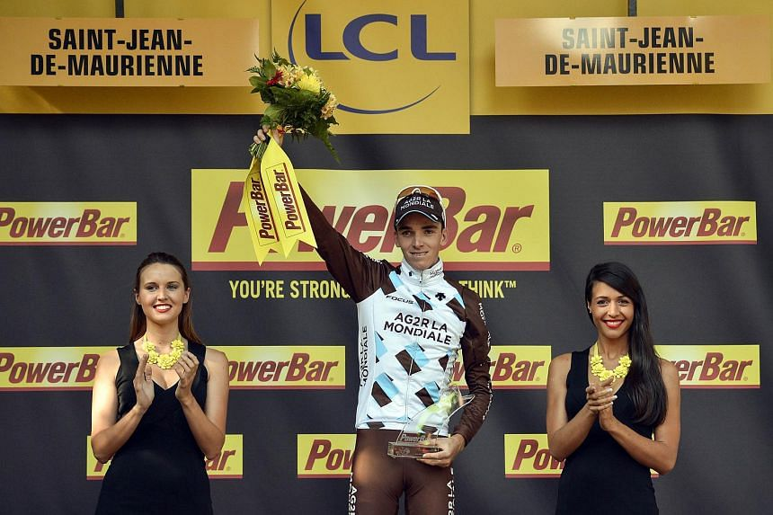 Romain Bardet celebrating on the podium after winning the Tour de France's 18th stage.