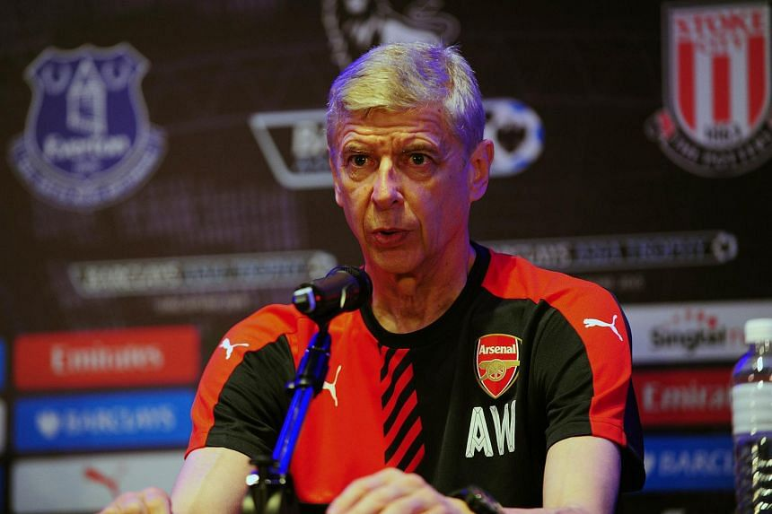 Arsenal manager Arsene Wenger speaks during a press conference for the Barclays Asia Trophy 2015 in Singapore on July 14, 2015.