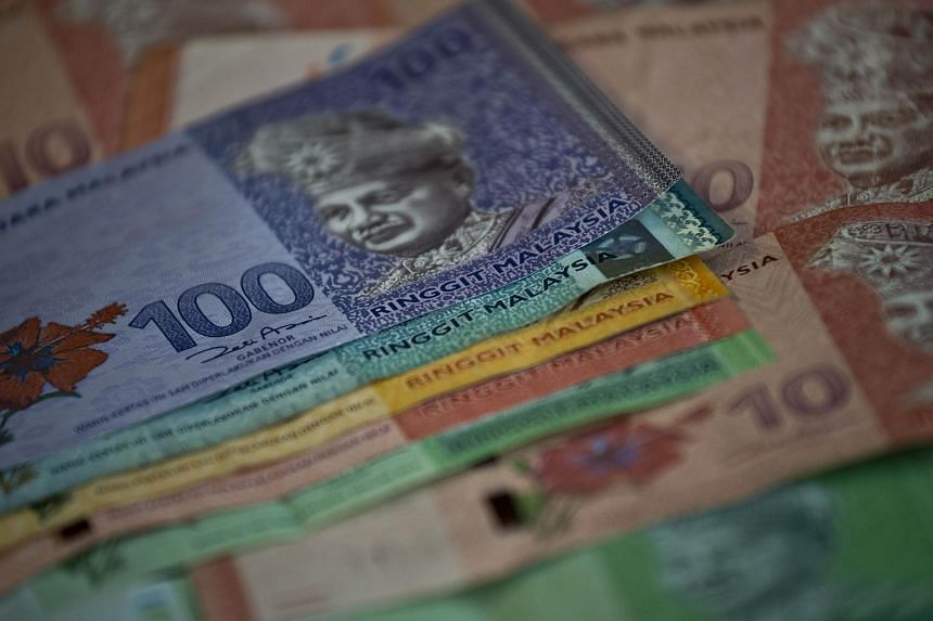 The ringgit dropped 0.4 per cent to 3.8063 a dollar in Kuala Lumpur on Thursday, the biggest loss since July 6.