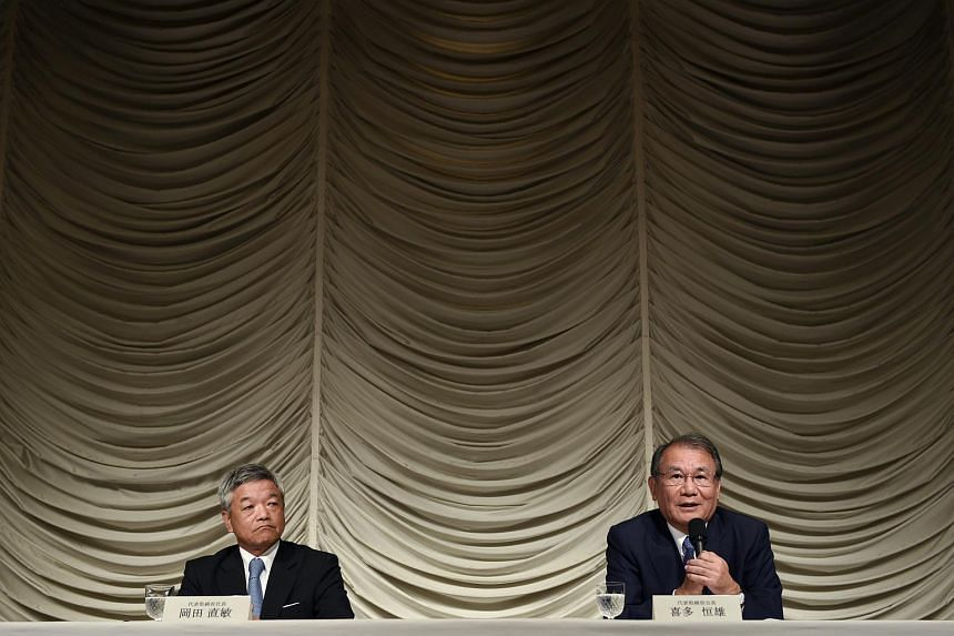Nikkei Chairman Tsuneo Kita (right) speaks during a press conference next to President and CEO Naotoshi Okada in Tokyo, Japan on July 24, 2015.