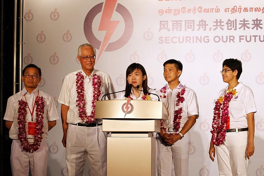 Tin Pei Ling (centre) speaking after the PAP's victory in Marine Parade GRC at the 2011 General Election.