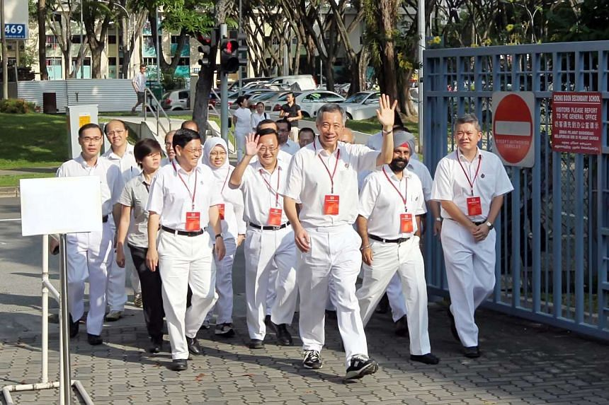 Prime Minister Lee Hsien Loong arriving at a polling station during the 2011 General Election.