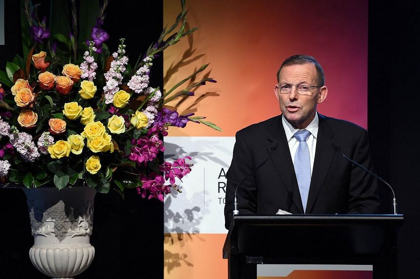 Australian Prime Minister Tony Abbott delivers his key notes at the Regional Countering Violent Extremism Summit in Sydney on June 11, 2015.