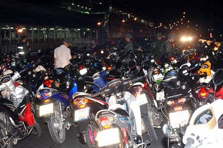 Street racers sometimes gather in the hundreds and ride recklessly.