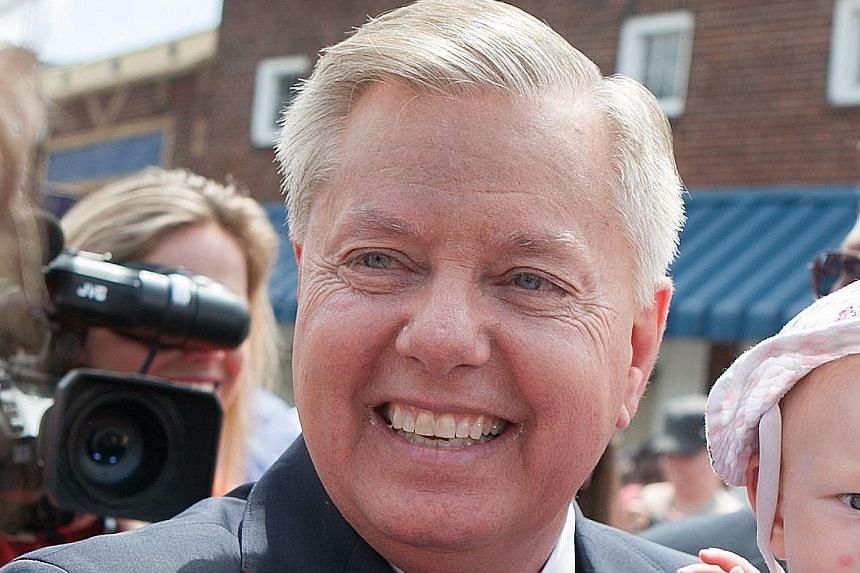 Mr Lindsey Graham can be seen on YouTube wrecking his old phone.