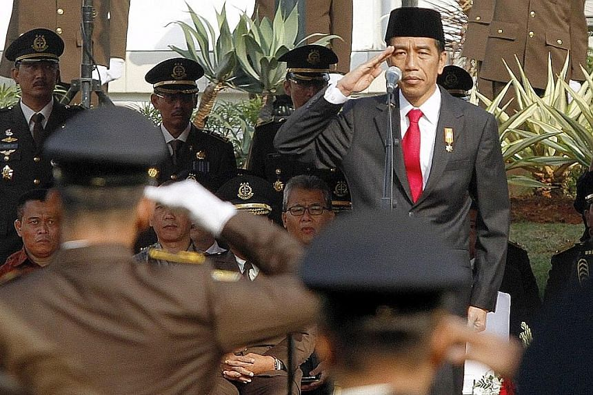 Mr Joko Widjojo at an event at the Attorney-General's office in Jakarta on Wednesday. The President is reportedly frustrated that infrastructure projects have been hindered by staffing delays and ministerial meddling with selection panels.