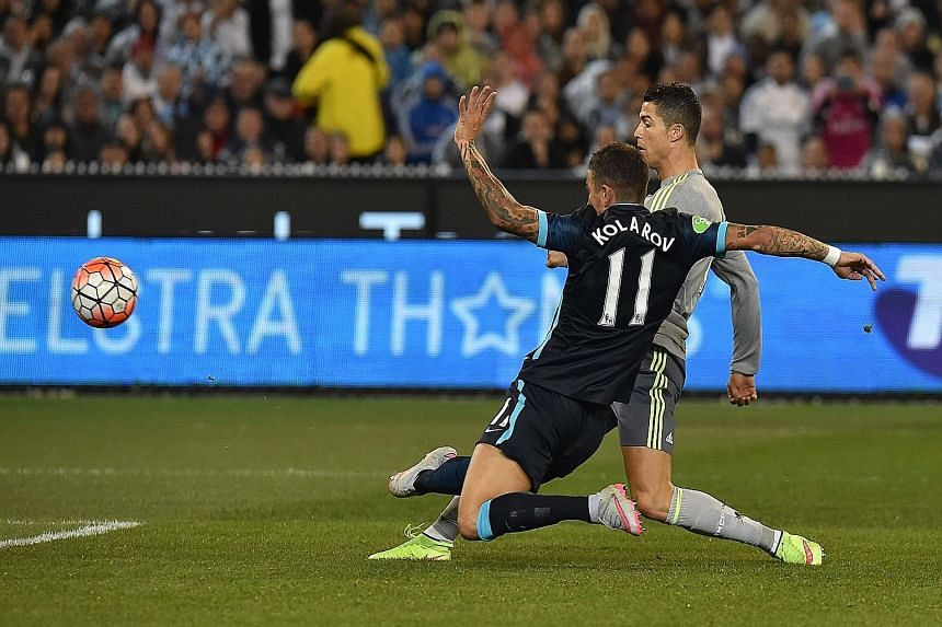 Real midfielder Cristiano Ronaldo shooting past City's Aleksandar Kolarov for his team's second goal in their 4-1 win in the International Champions Cup.