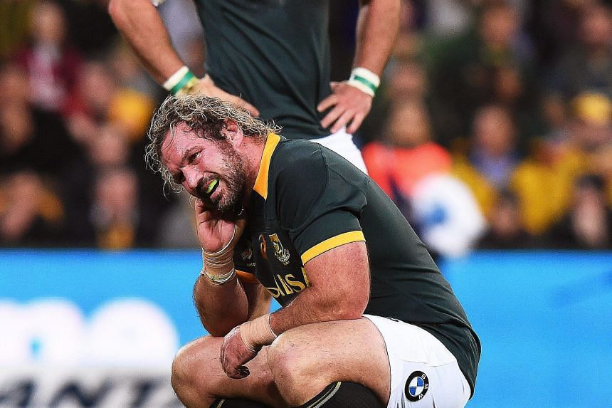 South Africa's Jannie Du Plessis (front) shows the anguish of the dramatic last-gasp loss to the Wallabies in Brisbane on July 18. PHOTO: EPA