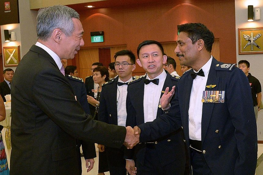 Prime Minister Lee Hsien Loong greeting Senior Warrant Officer Selvanathan Selvarajoo at last night's dinner.