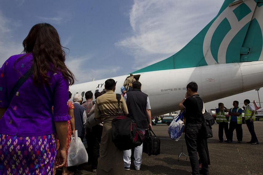 Travelers board an Air Bagan Ltd. aircraft.