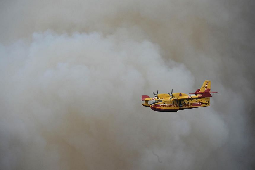 Two water bombers are working to contain the forest fire, with another two due to join during the day on Saturday.