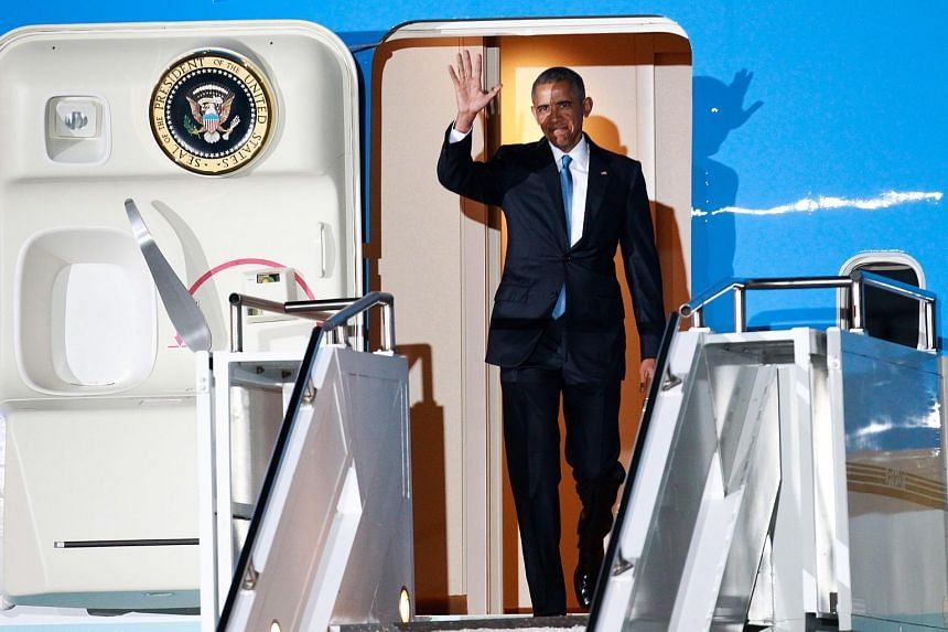 US President Barack Obama waves after landing at the Jomo Kenyatta International Airport (JKIA) in Nairobi, Kenya, on July 24, 2015.