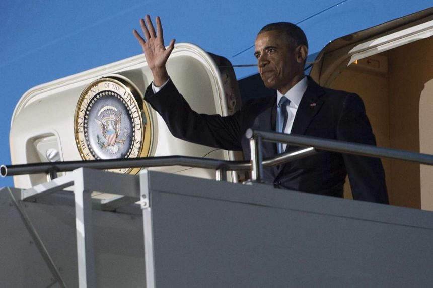 US President Barack Obama disembarks from Air Force One upon his arrival in Kenya for a landmark visit.