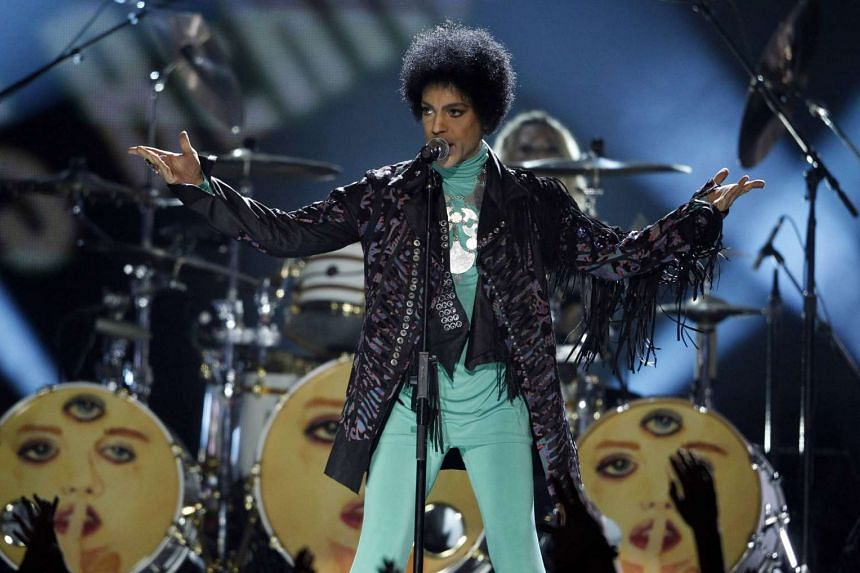 Prince performs during the Billboard Music Awards in a 2013 file photo.