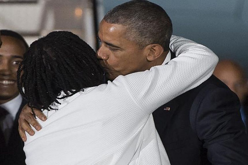 Obama is greeted by his half-sister, Auma Obama.