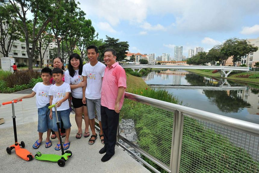 Mr Sitoh Yih Pin (in pink), seen here with some Potong Pasir residents, said yesterday he does not wish to lose a single member of the community as he has spent 15 years building relationships with them.